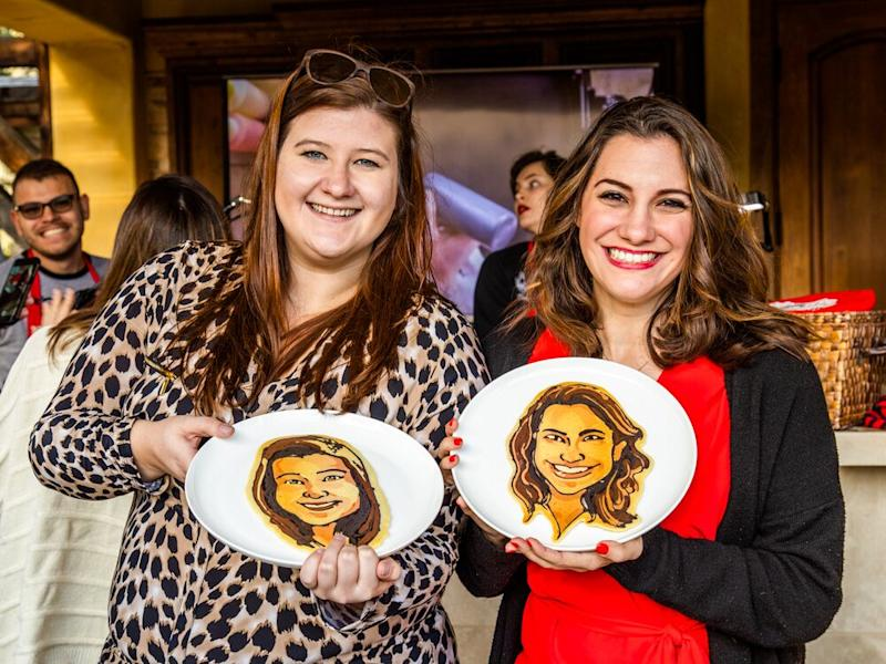 Winner Brittany Law (right) and guest show off their pancake portraits. | Sarah Crowder