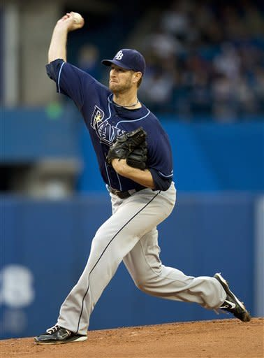 Tampa Bay Rays starting pitcher Jeff Niemann delivers to the Toronto Blue Jays during the first inning of a baseball game, Monday, May 14, 2012, in Toronto. (AP Photo/The Canadian Press, Frank Gunn)