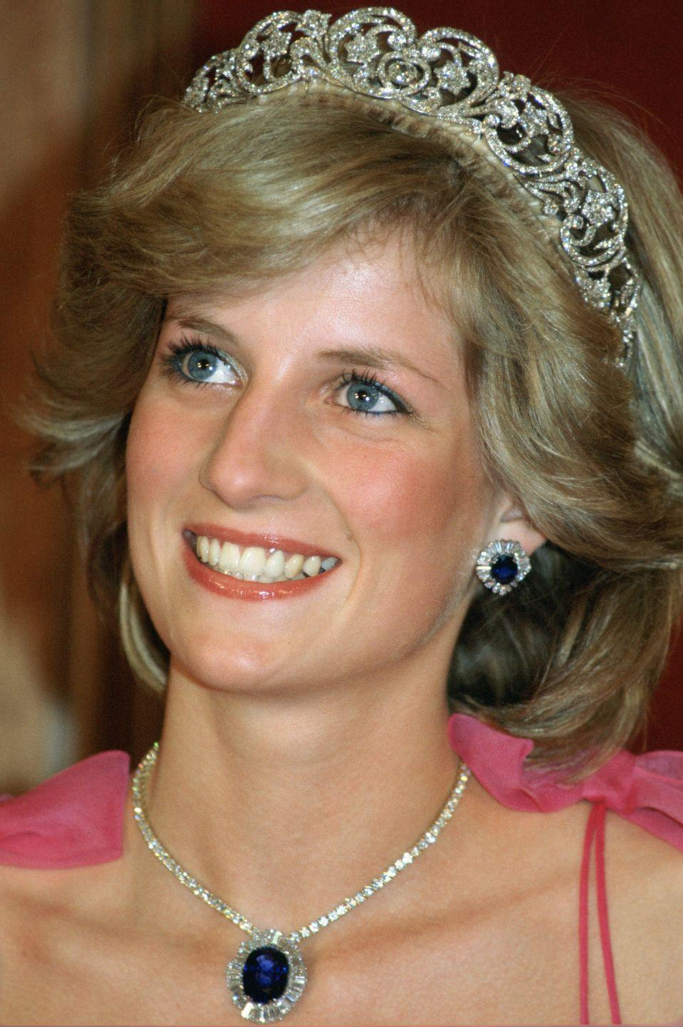 <p>Diana once again chose the Spencer tiara to attend a reception in Australia. This time, though, she paired the tiara with matching sapphire and diamond pieces—a wedding present to Diana from the Crown Prince of Saudi Arabia.<br></p>