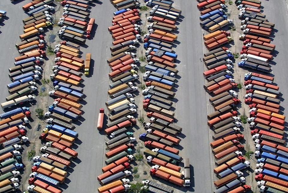 Hundreds of trucks stand idle as they wait to unload their cargo of soya,epa00158630 Hundreds of trucks stand idle as they wait to unload their cargo of soya, the trucks are stranded due to a strike at Paranagua Harbour, Brazil , Monday 22 March 2004. Most of the vehicles remain in the harbour parking area during the fourth strike day, at Sao Jose dos Pinhais, Brazil. Monday 22 March 2004. EPA/ALBARI ROSA BRAZIL OUT