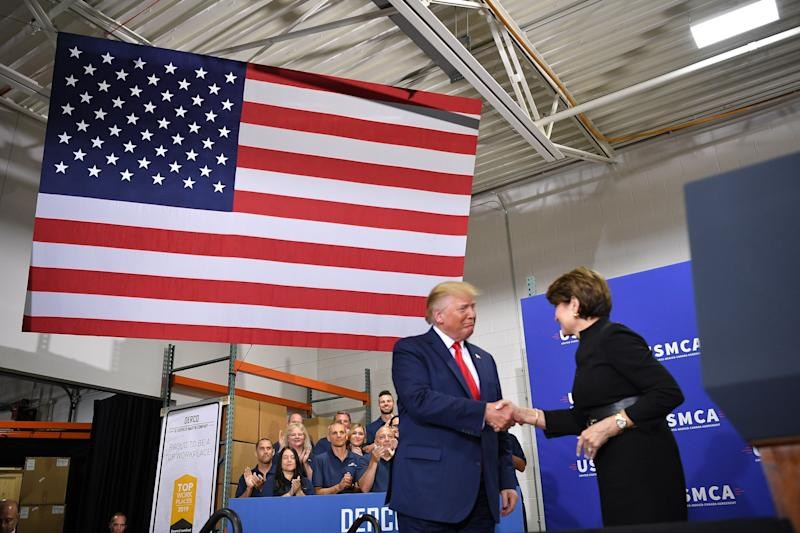 President Donald Trump greets then-Lockheed Martin CEO Marillyn Hewson at the Derco Aerospace Inc. plant in Milwaukee on July 12, 2019. Trump does not appear to be winning his political bet thatincreased defense spending would help his political fortunes. (Photo: MANDEL NGAN via Getty Images)