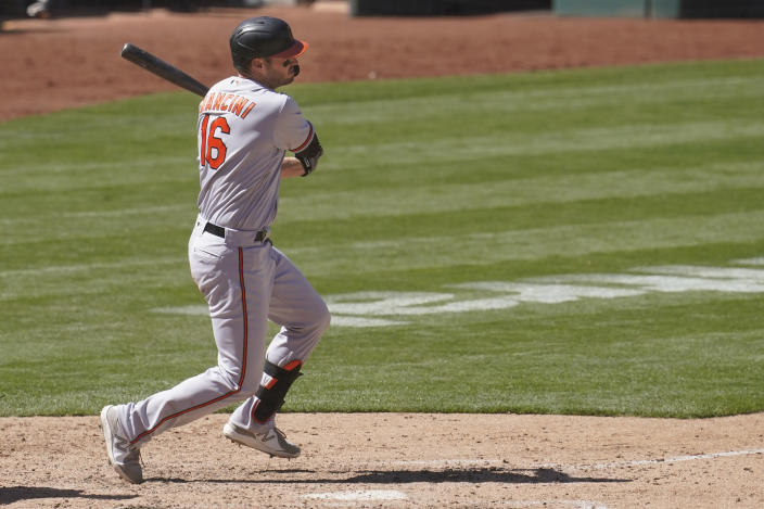 Baltimore Orioles' Trey Mancini hits an RBI-single against the Oakland Athletics during the seventh inning of a baseball game in Oakland, Calif., Sunday, May 2, 2021. (AP Photo/Jeff Chiu)