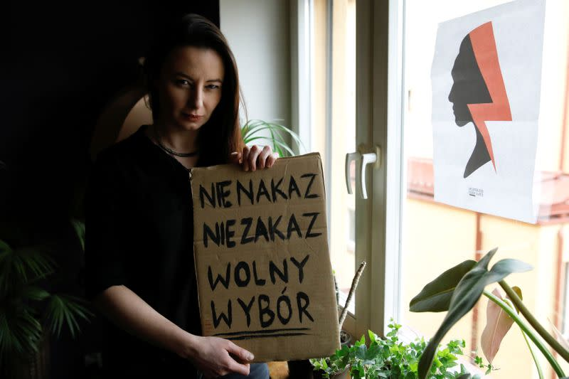 Katarzyna Lipka poses during an interview with Reuters at her home in Warsaw