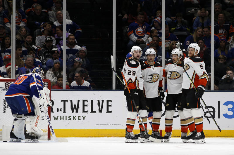 Anaheim Ducks center Adam Henrique (14) celebrates his goal against New York Islanders goaltender Semyon Varlamov (40) with teammates Devin Shore (29), Michael Del Zotto (44) and Korbinian Holzer (5) during the second period of an NHL hockey game, Saturday, Dec. 21, 2019, in Uniondale, N.Y. (AP Photo/Jim McIsaac)