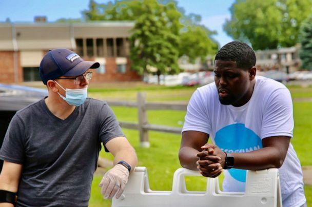 PHOTO: Pastor W. Seth Martin speaks with a member of his congregation at a community service event on June 6, 2020. (The Brook Community Church)