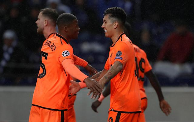 Soccer Football - Champions League Round of 16 First Leg - FC Porto vs Liverpool - Estadio do Dragao, Porto, Portugal - February 14, 2018 Liverpool's Roberto Firmino celebrates scoring their fourth goal with Georginio Wijnaldum and team mates Action Images via Reuters/Matthew Childs