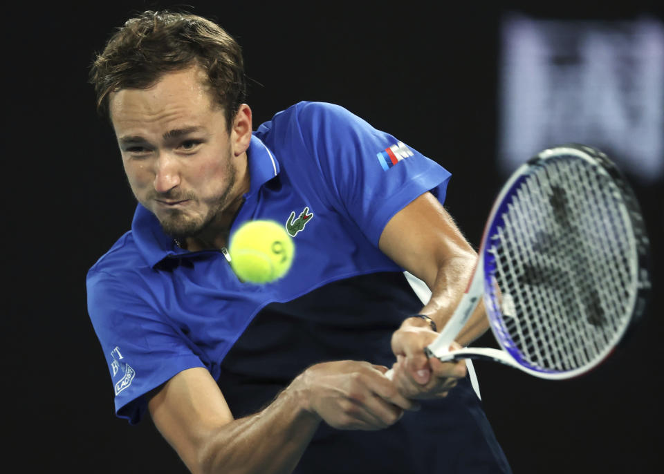 Russia's Daniil Medvedev makes a backhand return to Frances Tiafoe of the U.S. during their first round singles match at the Australian Open tennis championship in Melbourne, Australia, Tuesday, Jan. 21, 2020. (AP Photo/Lee Jin-man)
