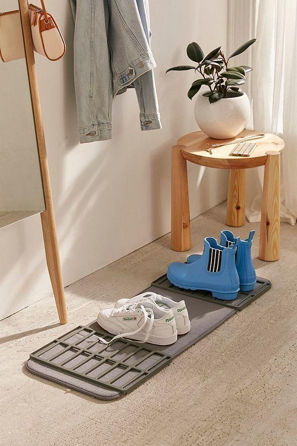 "Get it <a href=""https://www.urbanoutfitters.com/shop/shoe-drying-mat?category=bathroom-accessories&color=004"" target=""_blank"">here</a> for $16."
