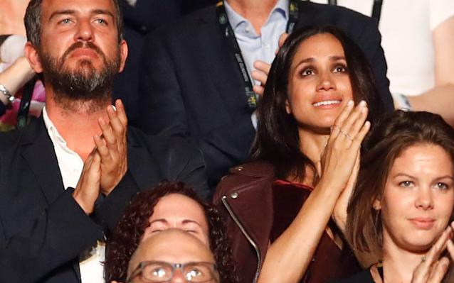 Meghan Markle watches the opening ceremony for the Invictus Games in Toronto - REUTERS