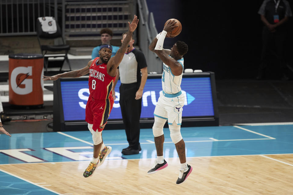Charlotte Hornets guard Terry Rozier (3) shoots over New Orleans Pelicans forward Naji Marshall (8) during the first half of an NBA basketball game Sunday, May 9, 2021, in Charlotte, N.C. (AP Photo/Brian Westerholt)