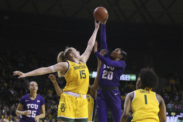 Baylor forward Lauren Cox (15) fouls TCU guard Lauren Heard (20) as she attempts a shot in the first half of an NCAA college basketball game, Wednesday, Feb. 12, 2020, in Waco, Texas. (AP Photo/Jerry Larson)