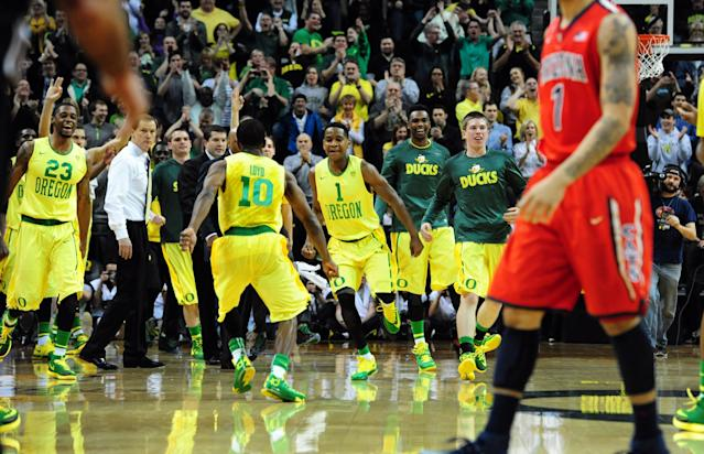 EUGENE, OR - MARCH 8: Johnathan Loyd #10 of the Oregon Ducks runs to celebrate with Dominic Artis #1 of the Oregon Ducks during the second half of the game against the Arizona Wildcats at Matthew Knight Arena on March 8, 2014 in Eugene, Oregon. Oregon won the game 64-57. (Photo by Steve Dykes/Getty Images)