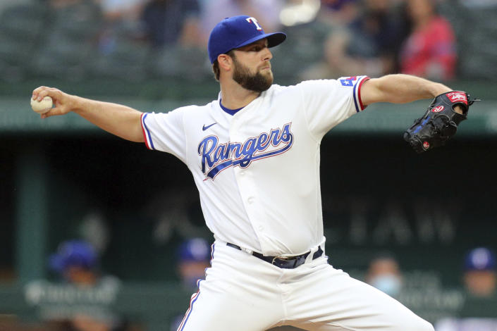 Texas Rangers starting pitcher Jordan Lyles delivers a pitch in the first inning against the Los Angeles Angels during a baseball game on Monday, April 26, 2021, in Arlington, Texas. (AP Photo/Richard W. Rodriguez)