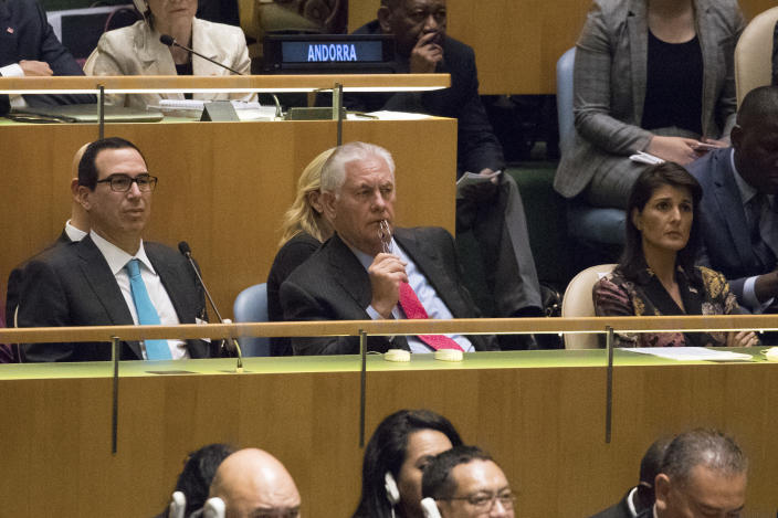 <p>Secretary of State Rex Tillerson, center, Ambassador to the United Nations Nikki Haley, right, and Secretary of the Treasury Steven Mnuchin listen as President Trump speaks during the 72nd session of the United Nations General Assembly at U.N. headquarters, Tuesday, Sept. 19, 2017. (Photo: Mary Altaffer/AP) </p>