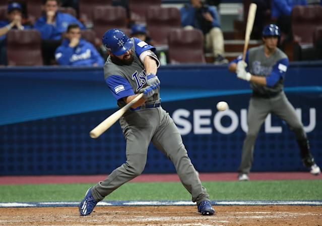 Cody Decker hits a single in the top of the seventh inning against Taiwan during the World Baseball Classic. (Getty Images)