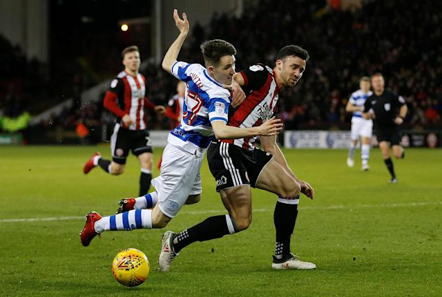 "Soccer Football - Championship - Sheffield United vs Queens Park Rangers - Bramall Lane, Sheffield, Britain - February 20, 2018 Queens Park Rangers' Paul Smyth in action with Sheffield United's Enda Stevens Action Images/Ed Sykes EDITORIAL USE ONLY. No use with unauthorized audio, video, data, fixture lists, club/league logos or ""live"" services. Online in-match use limited to 75 images, no video emulation. No use in betting, games or single club/league/player publications. Please contact your account representative for further details."