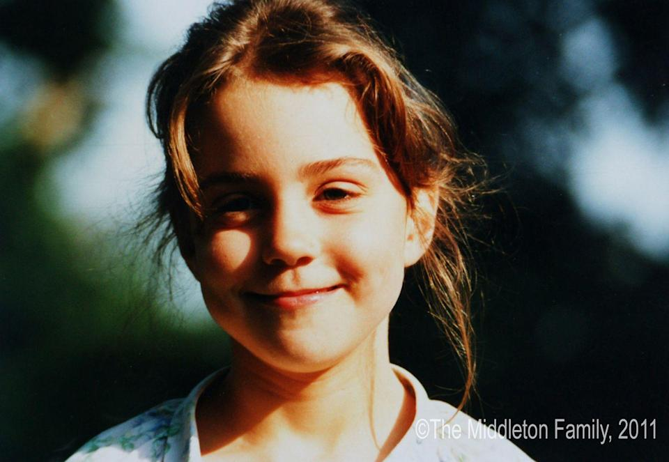 <p>Kate Middleton grinned for the camera at age five. The future Duchess grew up in a well-to-do family. She lived adjacent to the British aristocracy because of her father's ties, and her parents started Party Pieces, a business selling mail order party goods.</p>