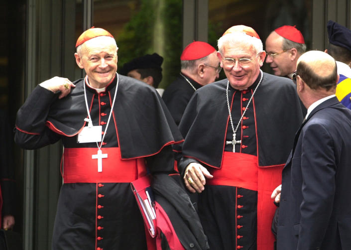 FILE - In this May 21, 2001 file photo, Cardinals William Henry Keeler, left, Archbishop of Baltimore, Md., and Theodore Edgar McCarrick, Archbishop of Washington, D.C., leave a major meeting with cardinals from around the world attended by Pope John Paul II in the Synod Hall at the Vatican. The Pontiff called the meeting to examine the challenges of the church in the new millennium. (AP Photo/ Massimo Sambucetti, File)