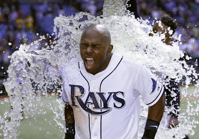 Tampa Bay Rays' Jason Bourgeois reacts as he is doused with ice following his walk off hit off Seattle Mariners relief pitcher Danny Farquhar during a baseball game Wednesday, Aug. 14, 2013, in St. Petersburg, Fla. The Rays defeated the Mariners 5-4. (AP Photo/Chris O'Meara)