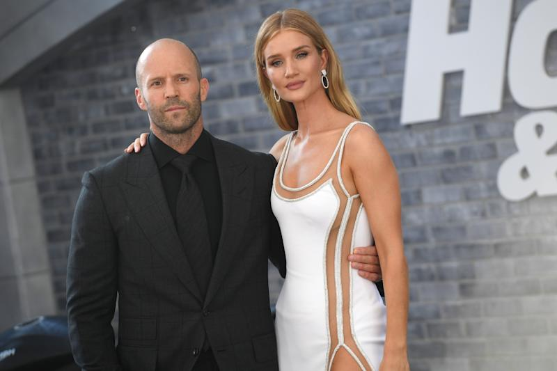 "English actor Jason Statham and English model Rosie Huntington-Whiteley attend the world premiere of ""Fast & Furious presents Hobbs & Shaw,"" at the Dolby Theatre in Hollywood California, July 13, 2019. (Photo by Robyn Beck / AFP) (Photo credit should read ROBYN BECK/AFP/Getty Images)"