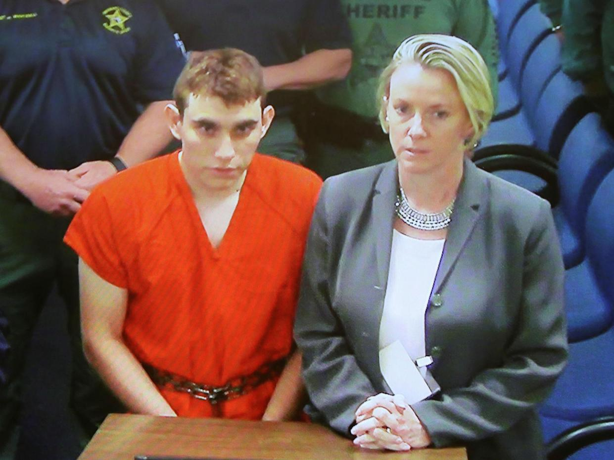 Nikolas Cruz appears via video monitor with his public defender Melisa McNeill at a bond court hearing in Fort Lauderdale, Florida: Reuters