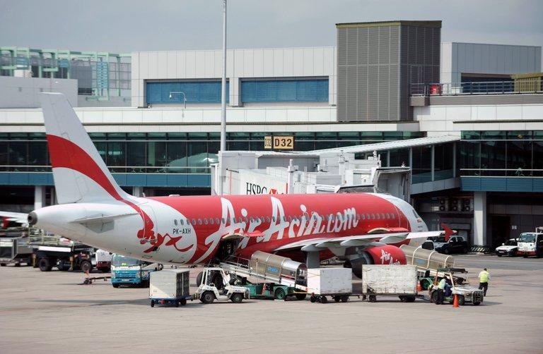 An AirAsia passenger plane is parked on the tarmac of the Changi International Airport in Singapore on July 12, 2012