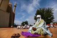 A man dressed in traditional attire is seen during Eid al-Adha prayers at the National Mosque, amid the outbreak of the coronavirus disease (COVID-19), in Abuja, Nigeria July 31, 2020. REUTERS/Afolabi Sotunde