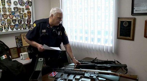 PHOTO: New Middletown, Ohio, Police Chief Vince D'Egidio shows off multiple semi-automatic rifles found at the home of James Reardon Jr., 20, who has been charged with making threats against a Jewish community center. (WYTV)