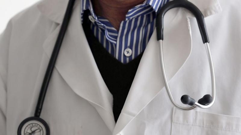 A photo illustration shows a French general practitioner with a stethoscope in a doctor's office in Bordeaux