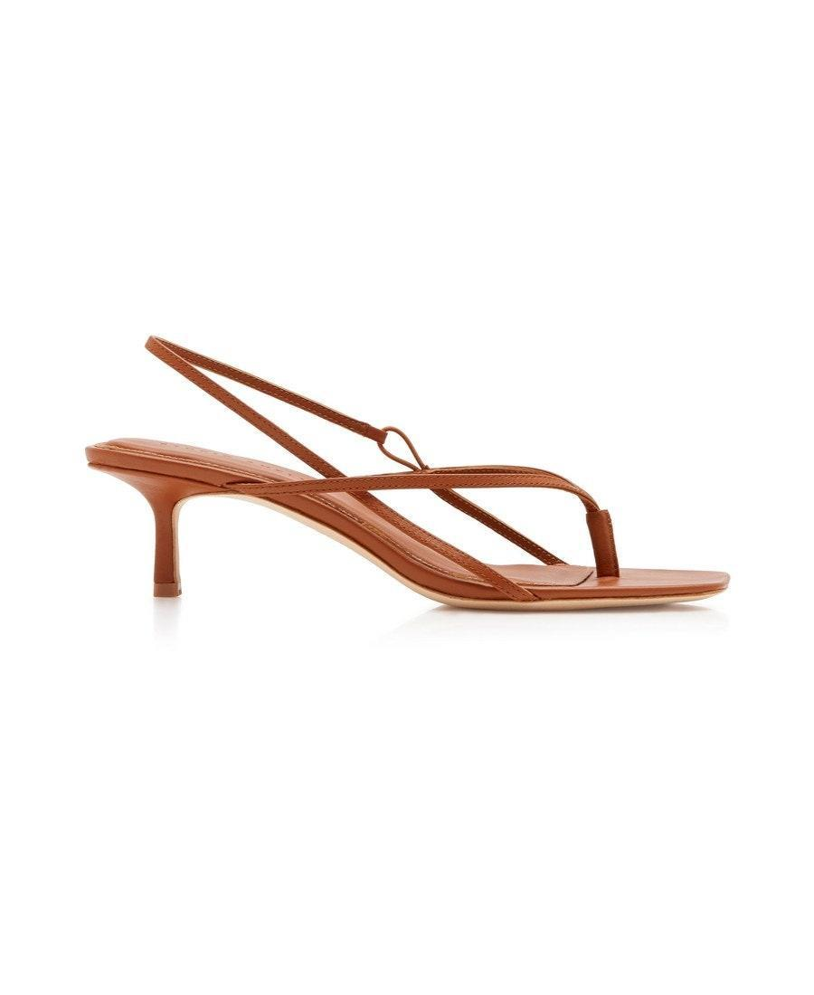 "$330, Moda Operandi. <a href=""https://www.modaoperandi.com/studio-amelia-r20/leather-slingback-sandals-4?color=neutral&material=Leather"" rel=""nofollow noopener"" target=""_blank"" data-ylk=""slk:Get it now!"" class=""link rapid-noclick-resp"">Get it now!</a>"