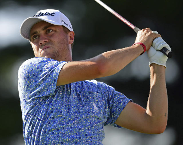 Justin Thomas watches his tee shot on the 17th hole during the third round of the Bridgestone Invitational golf tournament at Firestone Country Club, Saturday, Aug. 4, 2018, in Akron, Ohio. (AP Photo/David Dermer)