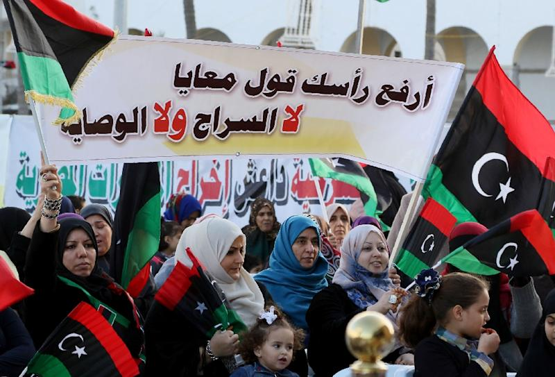 "Libyans hold a banner reading in Arabic, ""Lift your head and say no to Sarraj (Prime Minister-designate Fayez al-Sarraj); no to his rule,"" during a protest in Tripoli against the UN-backed unity government, on March 25, 2016 (AFP Photo/Mahmud Turkia)"