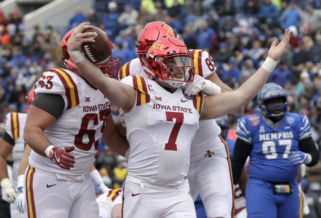 "Iowa State quarterback <a class=""link rapid-noclick-resp"" href=""/ncaaf/players/227145/"" data-ylk=""slk:Joel Lanning"">Joel Lanning</a> (7) celebrates after scoring a touchdown against Memphis in the first half of the Liberty Bowl NCAA college football game Saturday, Dec. 30, 2017, in Memphis, Tenn. (AP Photo/Mark Humphrey)"