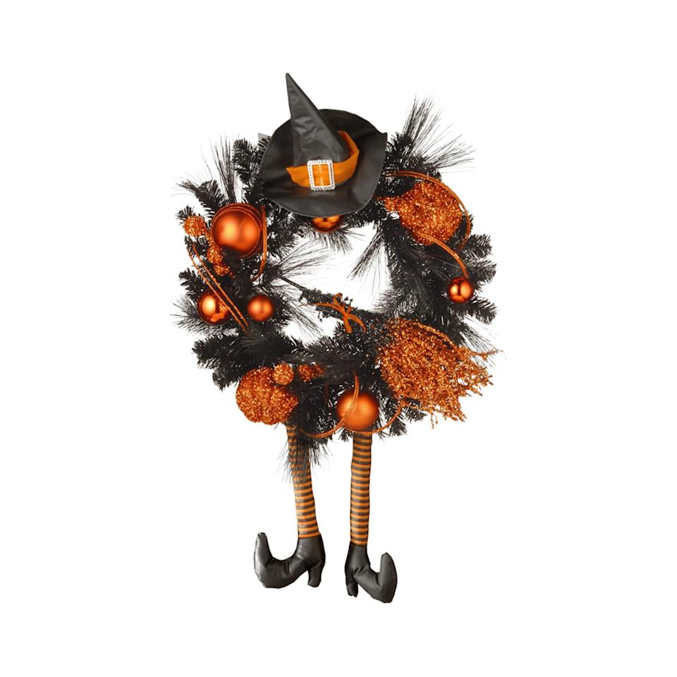 """<p><strong>BUY IT:</strong> $45.99; <a href=""""https://www.amazon.com/National-Tree-Company-Wreath-Orange/dp/B07SXKNF7L/ref=as_li_ss_tl?ie=UTF8&linkCode=ll1&tag=slhomespookyhalloweenwreathspshannon0920-20&linkId=1eac3610b3560ad615f8c203ee6c43d1&language=en_US"""" rel=""""nofollow"""">amazon.com</a></p> <p>If your taste skews a little more cute that creepy, this is the one for you. Sparkly trimmings, festive pumpkins, and a cute little witch's hat to top it all off are bound to bring your Halloween front door game to new heights.</p>"""