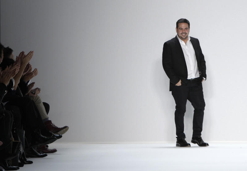 FILE - In this Feb. 14, 2012 file photo, designer Narciso Rodriguez appears on the runway at the end of the presentation of the his Fall 2012 collection during Fashion Week in New York. El Museo del Barrio will honor the designer of Cuban descent next month during its annual gala. In its announcement, El Museo said that Rodriguez is considered one of the 25 most influential Hispanics in America. (AP Photo/Kathy Willens, file)