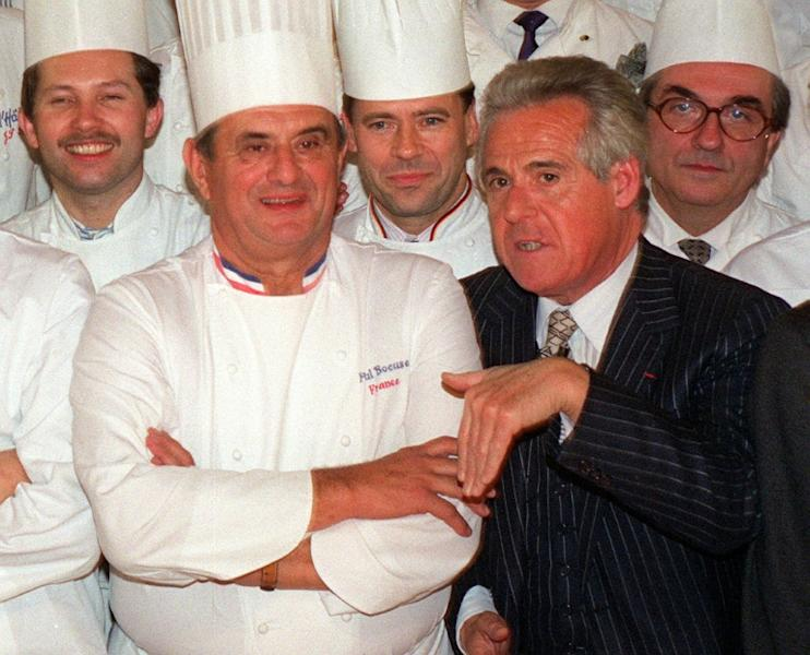 Celebrated French food critic Christian Millau (R) posing with French chef Paul Bocuse (2nd L) and other famous French chefs in Paris in 1989. The co-founder of the French restaurant guide Gault and Millau has died aged 88