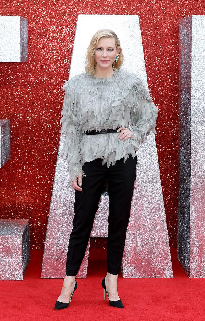 To join the star-studded cast on the red carpet, the actress chose a spotlight-stealing feathered ensemble by Louis Vuitton. Chic tailored trousers and an emerald ear cuff finished the look. [Photo: Getty]