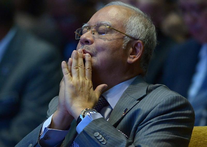 Malaysia's attorney general cleared premier Najib Razak of wrongdoing in accepting a mysterious $681 million payment from overseas, sparking accusations of a cover-up in a case that has shaken Najib's government to its core (AFP Photo/Mohd Rasfan)