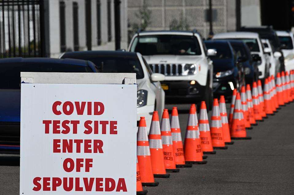 People arrive in cars for Covid-19 tests at a coronavirus testing site in Los Angeles, California on November 30, 2020 following the Thanksgiving holiday. - Los Angeles County's new stay-at-home restrictions took effect on November 30, 2020, one day after the county reported more than 5,000 new COVID-19 cases. (Photo by Robyn Beck / AFP) (Photo by ROBYN BECK/AFP via Getty Images)