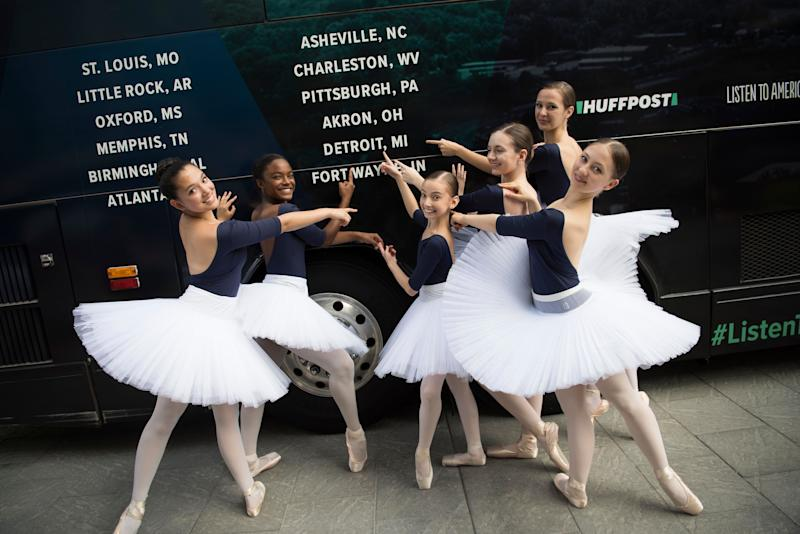 Dancers from Ballet Detroit pose for a photoin front of the bus.