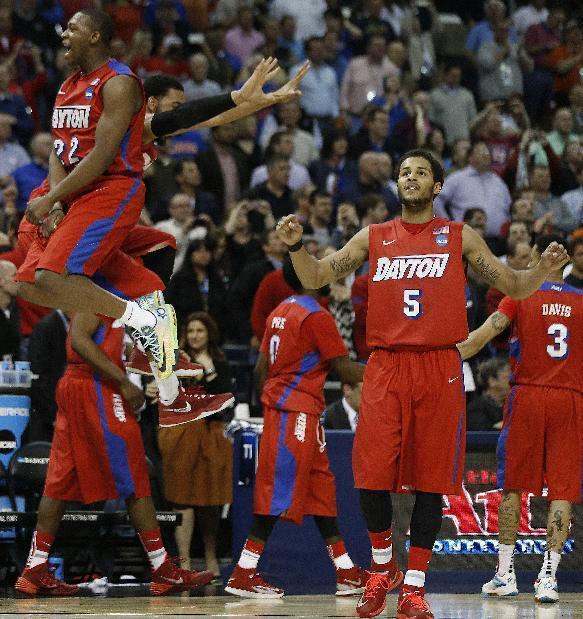 Dayton forward Kendall Pollard (22) celebrates after the second half in a regional semifinal game against Stanford at the NCAA college basketball tournament, Thursday, March 27, 2014, in Memphis, Tenn. Dayton won 82-72. (AP Photo/John Bazemore)