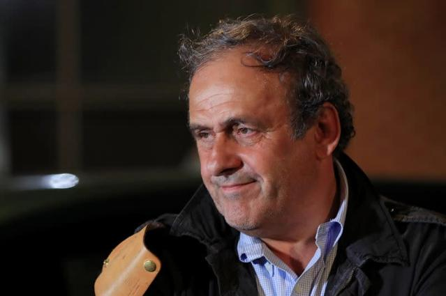 Former head of European football association UEFA Michel Platini leaves a judicial police station where he was detained for questioning over the awarding of the 2022 World Cup soccer tournament, in Nanterre