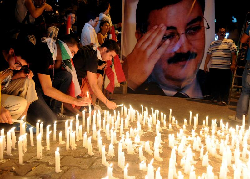 Lebanese mourners light candles during a vigil for Brig. Gen. Wissam al-Hassan and at least seven others who were killed in a Friday bomb attack in Beirut, Saturday, Oct. 20, 2012. The government declared a national day of mourning for the victims on Saturday, but protesters took to the streets, burning tires and setting up roadblocks around the country in a sign of the boiling anger over the massive bomb that Lebanon's prime minister linked  to the civil war in neighboring Syria. (AP Photo/Ahmad Omar)
