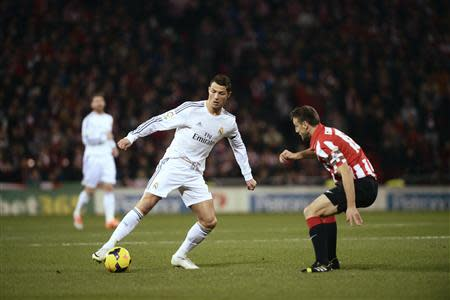 Real Madrid's Cristiano Ronaldo fights for the ball with Athletic Bilbao's Carlos Gurpegi during their Spanish first division soccer match at San Mames stadium in Bilba