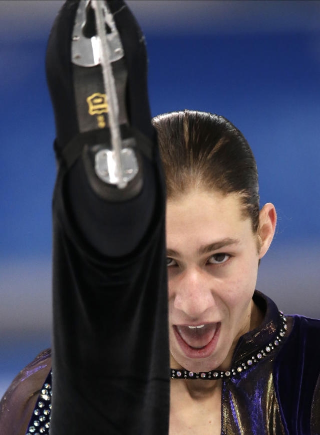 Jason Brown of the United States competes in the men's short program figure skating competition at the Iceberg Skating Palace during the 2014 Winter Olympics, Thursday, Feb. 13, 2014, in Sochi, Russia. (AP Photo/Bernat Armangue)