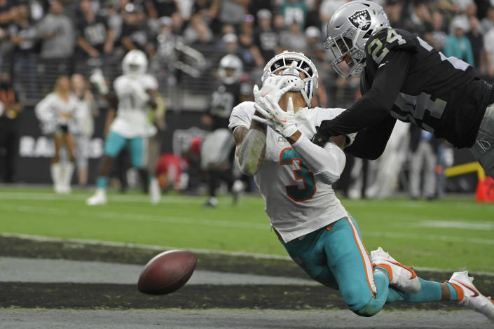 Miami Dolphins wide receiver Will Fuller (3) misses a catch attempt in the end zone against Las Vegas Raiders defensive back Johnathan Abram (24) during overtime of an NFL football game, Sunday, Sept. 26, 2021, in Las Vegas. (AP Photo/David Becker)