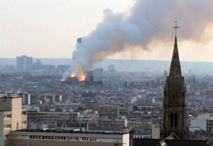 Plumes of smoke rises from Notre Dame cathedral burning in Paris, Monday, April 15, 2019.  Massive plumes of smoke fills the air above Notre Dame Cathedral and ash is reported to be falling on tourists and others around the island that marks the center of Paris. (Photo: AP)