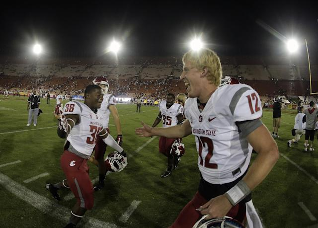 Washington State quarterback Connor Halliday, right, celebrates the team's win with Gerard Wicks after an NCAA college football game against Southern California in Los Angeles, Saturday, Sept. 7, 2013. (AP Photo/Chris Carlson)