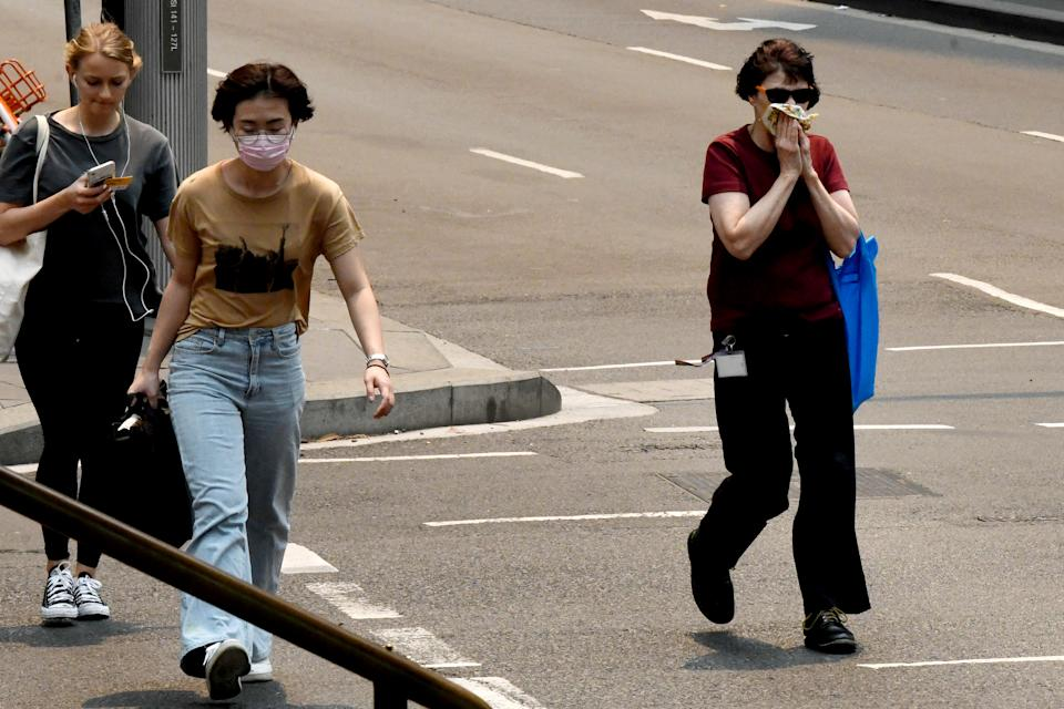 People are seen wearing face masks in Sydney.