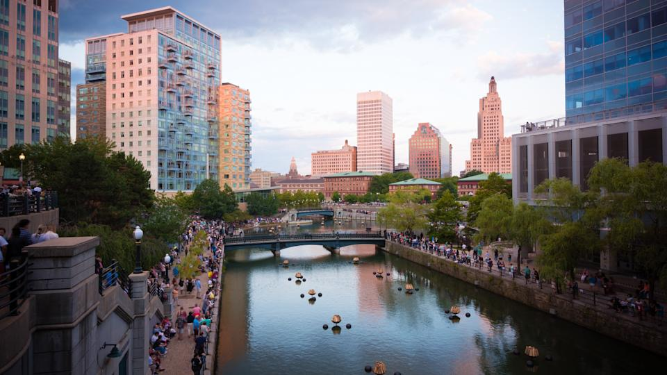 Crowds gather along Woonasquatucket river in Providence, RI in preparation for the summer series known as WaterFire, which consists of fiery wooden blocks placed along the river during the nighttime.